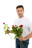Handsome man is giving bouquet of roses Stock Image
