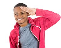 Handsome man giving hand salute Royalty Free Stock Photography