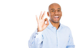 Handsome man giving an OK sign Stock Images