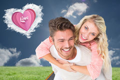 Handsome man giving piggy back to his girlfriend Royalty Free Stock Photo