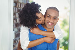 Handsome man giving piggy back to his girlfriend. Handsome men giving piggy back to his girlfriend out of their house Royalty Free Stock Photography