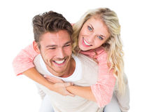 Handsome man giving piggy back to his girlfriend Stock Image