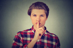 Handsome man giving Shhhh quiet, silence gesture Stock Photos