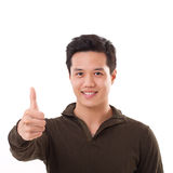 Handsome man giving thumb up, white isolated Stock Photo