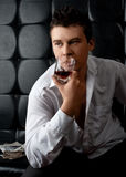 Handsome man with glass of whiskey Royalty Free Stock Photo