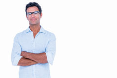 Handsome man with glasses looking at camera with arms crossed Stock Photo