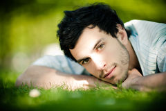 Handsome man on grass Royalty Free Stock Photography