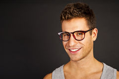 Handsome man in gray tank top with smile Royalty Free Stock Image