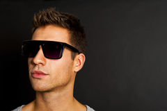 Handsome man in gray tank top with smile and sunglasses Stock Image