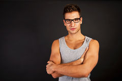 Handsome man in gray tanktop with smile and sunglasses Stock Image