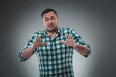Handsome man with green shirt says stop Royalty Free Stock Images