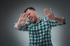 Handsome man with green shirt says stop Royalty Free Stock Photo