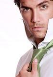 Handsome man with green tie. Handsome man is wearing is stylish green tie . Studio shot stock photos