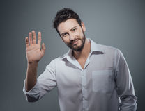 Handsome man greeting Stock Photo
