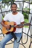 Handsome man with a guitar Royalty Free Stock Photo
