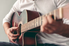 Handsome man with guitar Royalty Free Stock Image