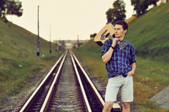 Handsome man with guitar in hand. Outdoors Stock Photo