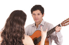 Handsome man with guitar serenading young girl Stock Photo