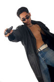 Handsome man with gun Royalty Free Stock Images