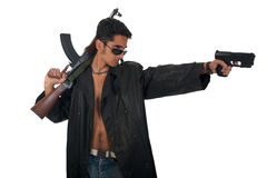 Handsome man with gun in leather raincoat. Royalty Free Stock Photo