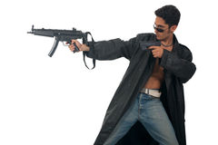 Handsome man with gun in leather raincoat. Isolated on white background Stock Photos