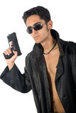 Handsome man with gun in leather raincoat Stock Photo