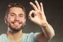 Handsome man guy giving ok sign gesture. Stock Image