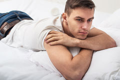 Handsome man guy in white T-shirt and blue jeans Stock Photography
