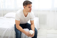Handsome man guy in white T-shirt and blue jeans Stock Photos