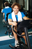 Handsome man at the gym doing static cycling Royalty Free Stock Images