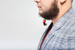 Handsome man with hair clips on beard Royalty Free Stock Image