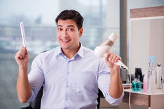 The handsome man in hair salon doing haircut Royalty Free Stock Photos