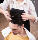 Handsome man in hairdressing saloon Royalty Free Stock Image