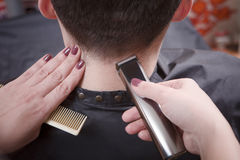 Handsome man in hairdressing saloon stock image