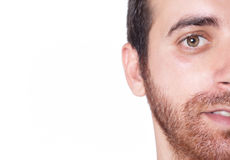 Handsome man half face close up. Charming and handsome man half face close up Royalty Free Stock Photo