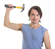Handsome man with hammer. Isolated on white Stock Images