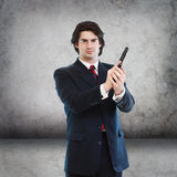 Handsome Man with a Hand Gun Royalty Free Stock Photos