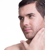 Handsome man with hand near the face. Royalty Free Stock Image