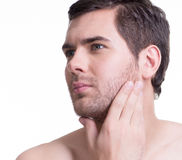 Handsome man with hand near the face. Royalty Free Stock Photo