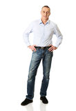 Handsome man with hands on hips Royalty Free Stock Photos
