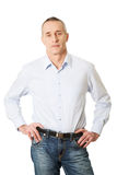 Handsome man with hands on hips Stock Images