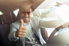 Handsome man happy after buying new car Stock Photo