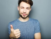 Handsome man happy smile, hold hand with ok gesture sign Royalty Free Stock Images