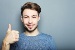 Handsome man happy smile, hold hand with ok gesture sign Royalty Free Stock Photos