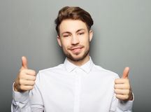Handsome man happy smile, hold hand with ok gesture sign Royalty Free Stock Photography