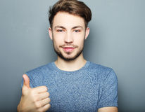 Handsome man happy smile, hold hand with ok gesture sign Stock Photos