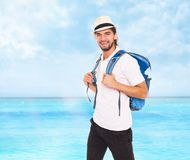Handsome man in hat with backpack, smile Stock Photos