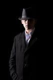 Handsome man in hat in the dark Stock Photos