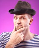 Handsome man in hat Stock Images