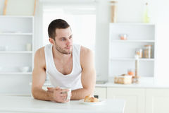 Handsome man having breakfast Stock Images